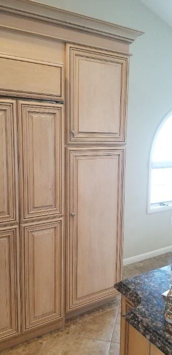 Pantry cabinets adjacent to Sub-Zero fridge