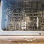 Interior of top dishwasher drawer